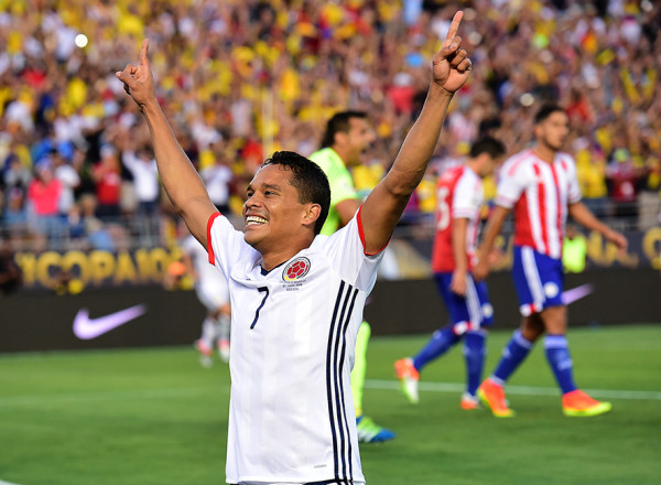 Colombia's Carlos Bacca celebrates after scoring against Paraguay during a Copa America Centenario football match in Pasadena, California, United States, on June 7, 2016. / AFP PHOTO / Frederic J. Brown